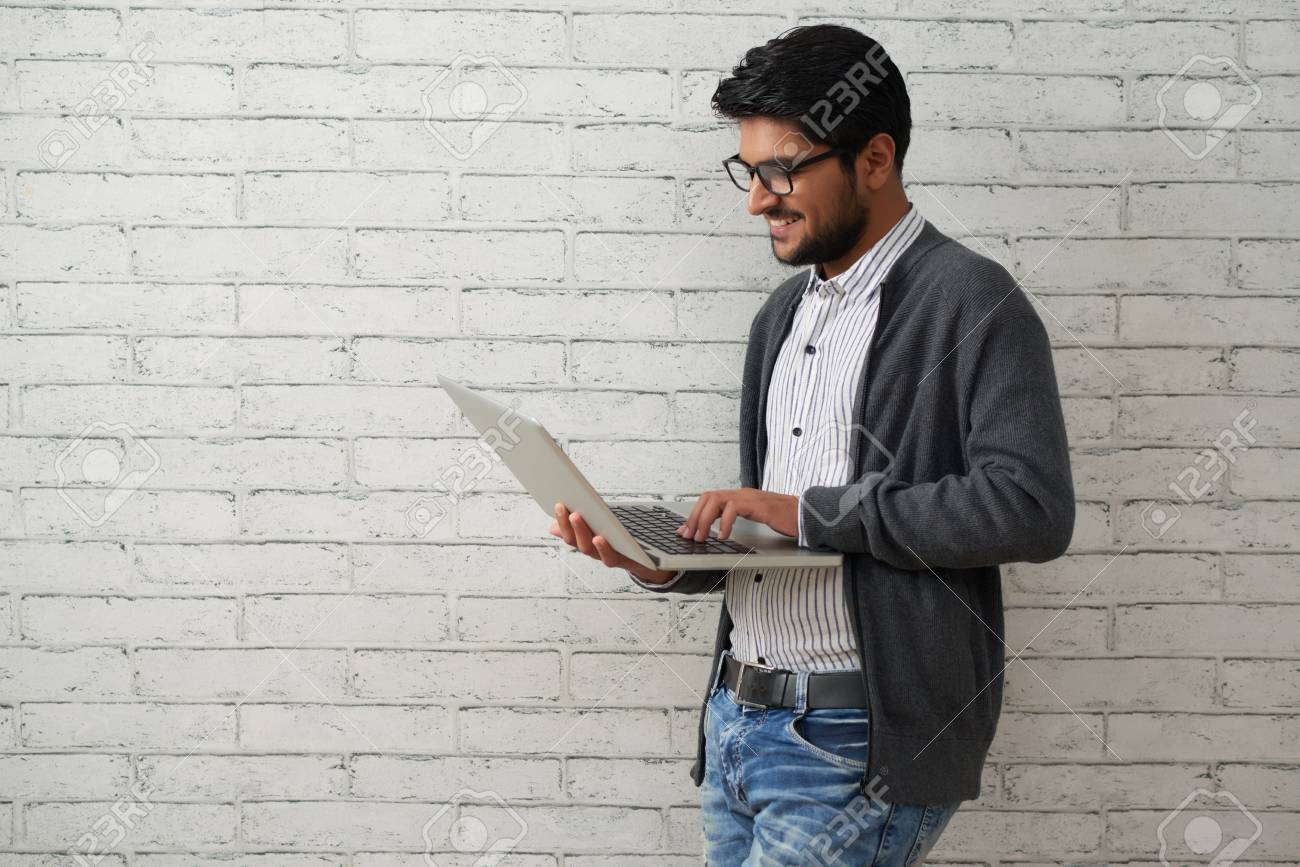 Cheerful programmer with laptop - 118147549