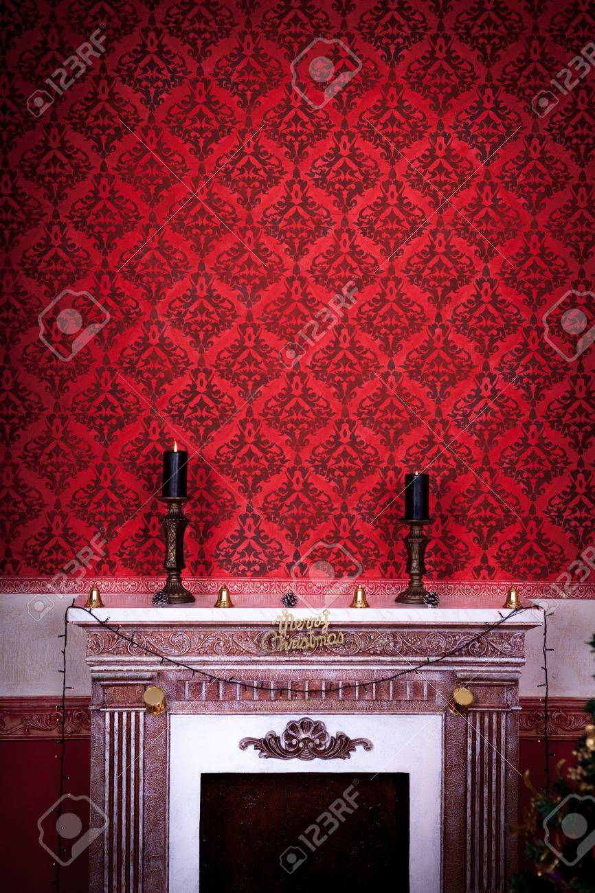 Vintage room with two candels on a fireplace on a red background Sensasional vintage Christmas interior studio shot Stock Photo - 21773797