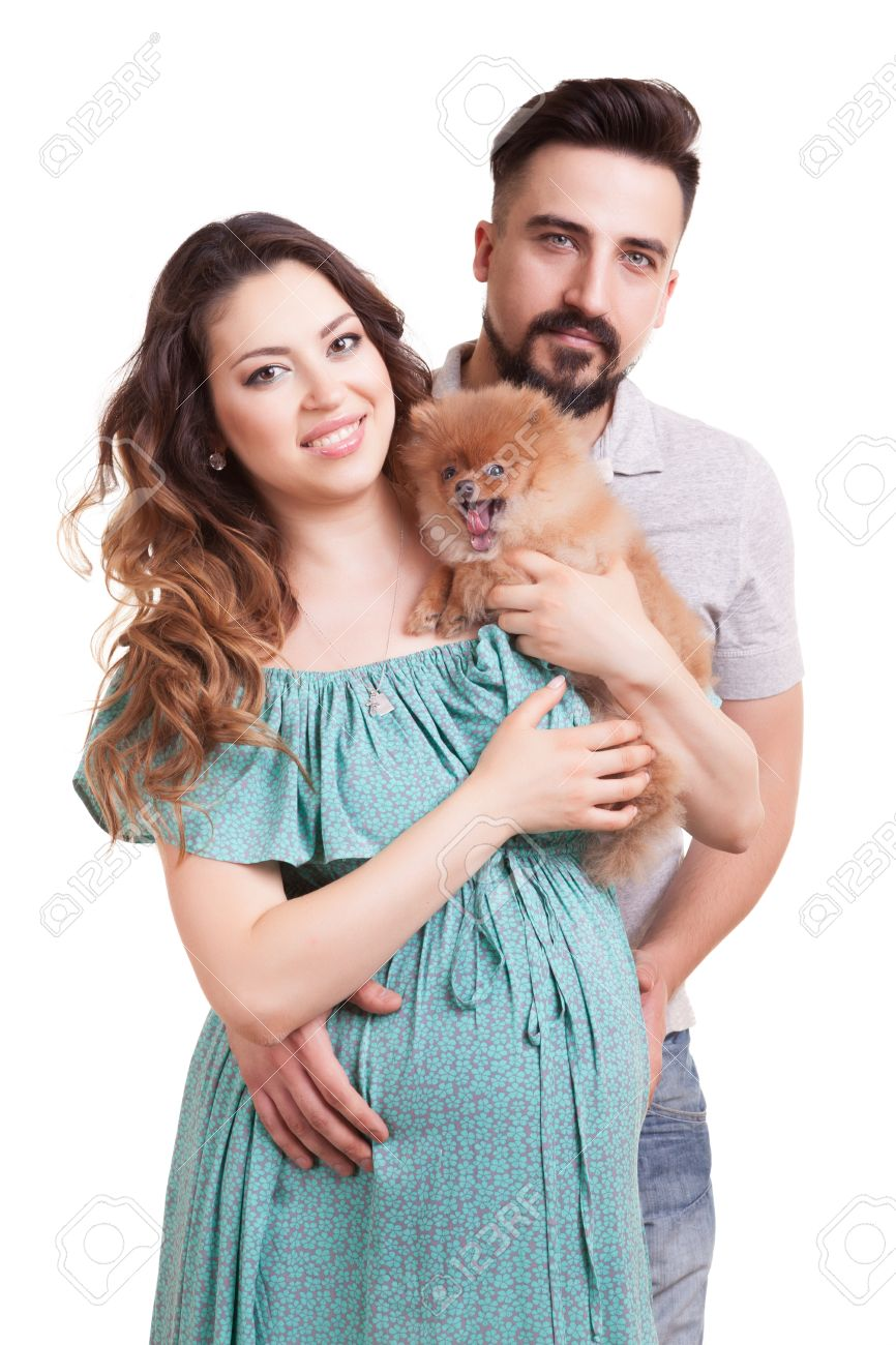 Happy Familly With Pregnant Woman And Dog In Hands Smiling Husband ...