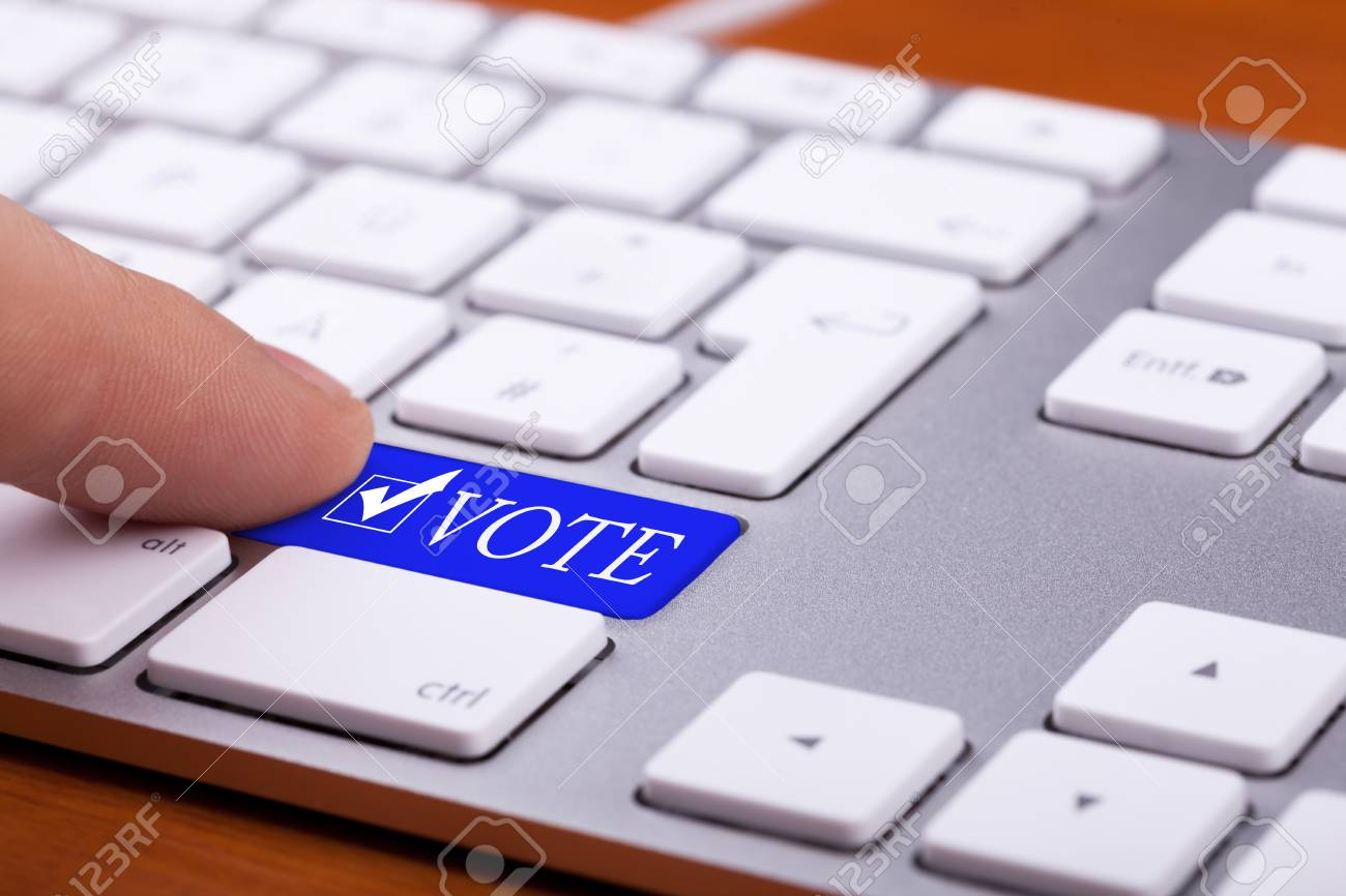 Finger Pressing On Vote Blue Button And Symbol On Keyboard Online