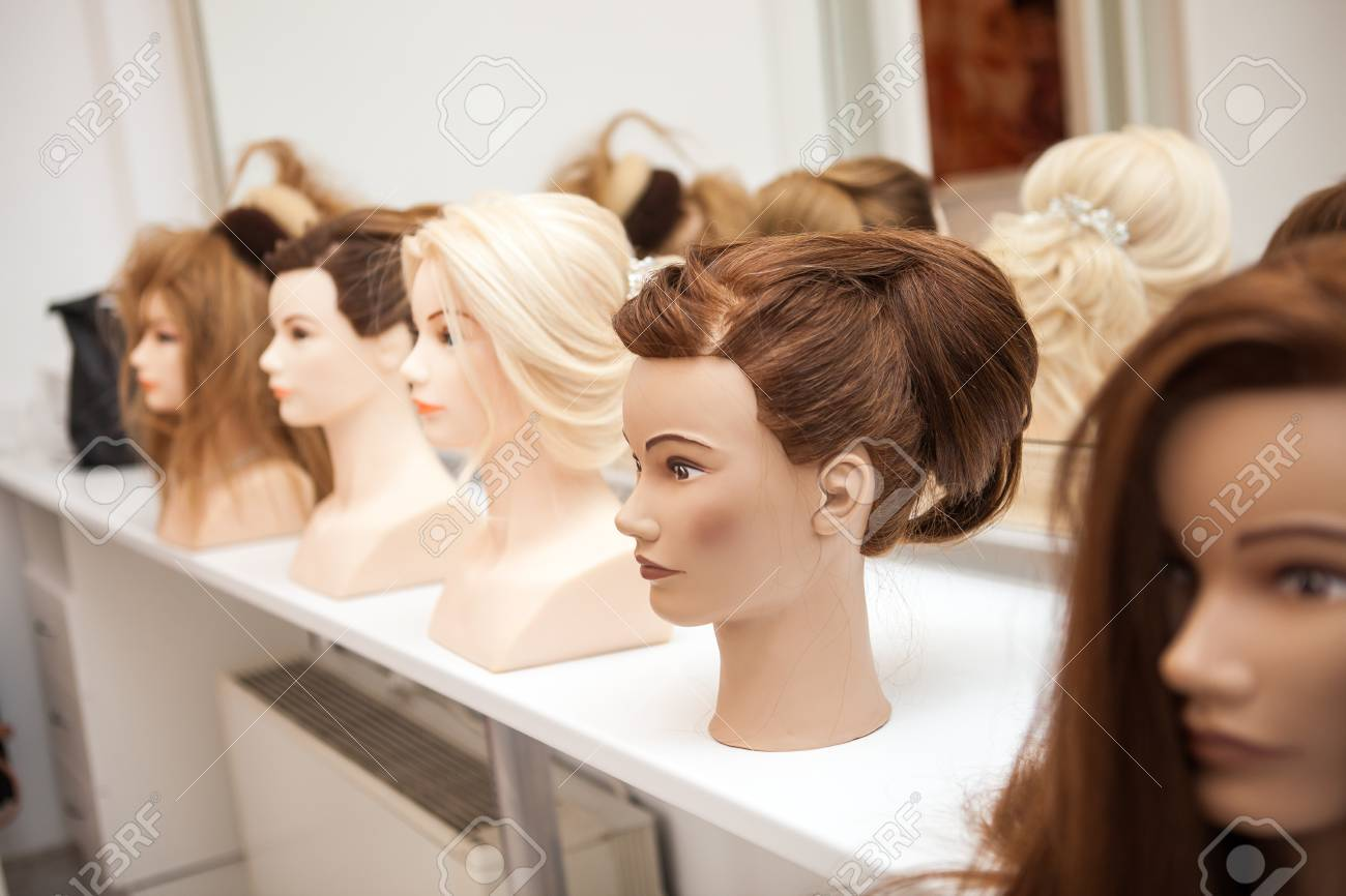 Different mannequin with different hairstyles on a stand. Dummy..