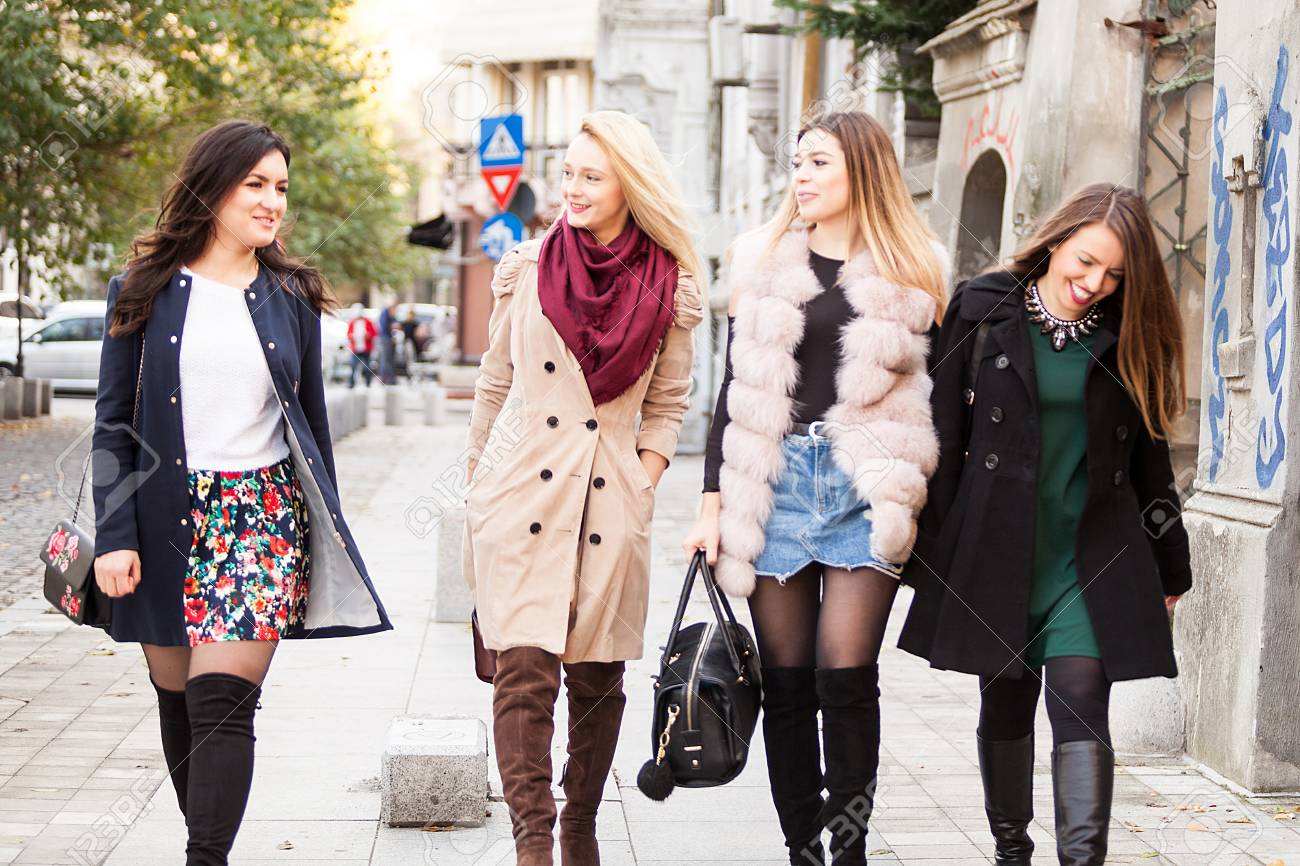 Group Of Four Best Friends Women In The City Walking Laughing Stock Photo Picture And Royalty Free Image Image 90596825