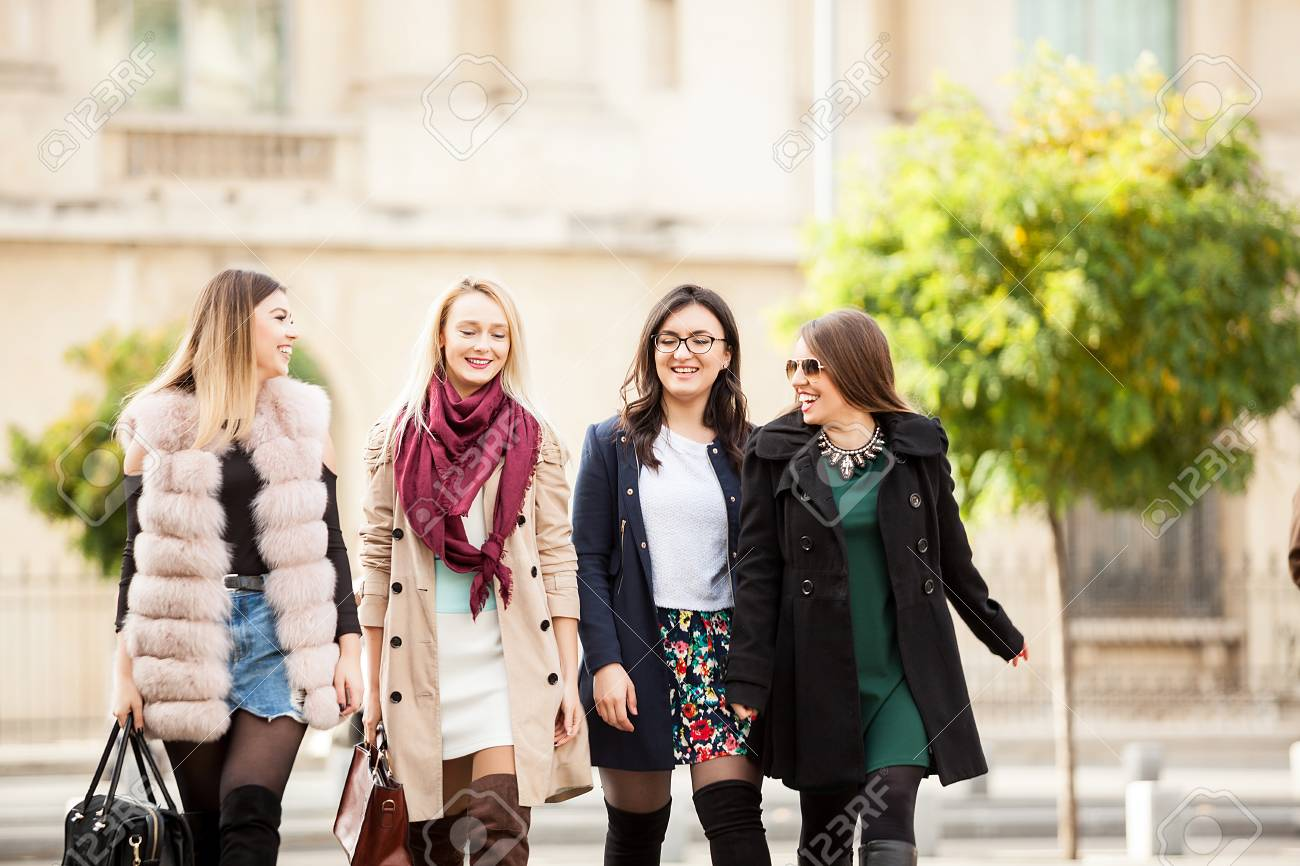 Group Of Four Best Friends Women In The City Walking Laughing Stock Photo Picture And Royalty Free Image Image 90659047