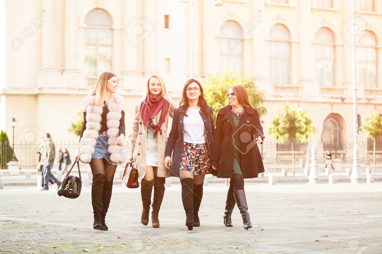 Group Of Four Best Friends Women In The City Walking Laughing Stock Photo Picture And Royalty Free Image Image 90597183