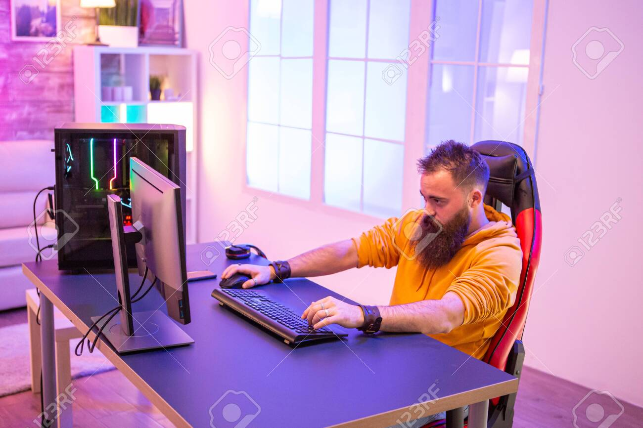 Professional Gamer With Long Beard In Front Of Powerful Gaming.. Stock  Photo, Picture And Royalty Free Image. Image 137793521.