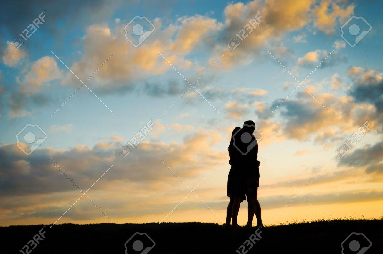 Silhouette young couple  at sunset Stock Photo - 10919836