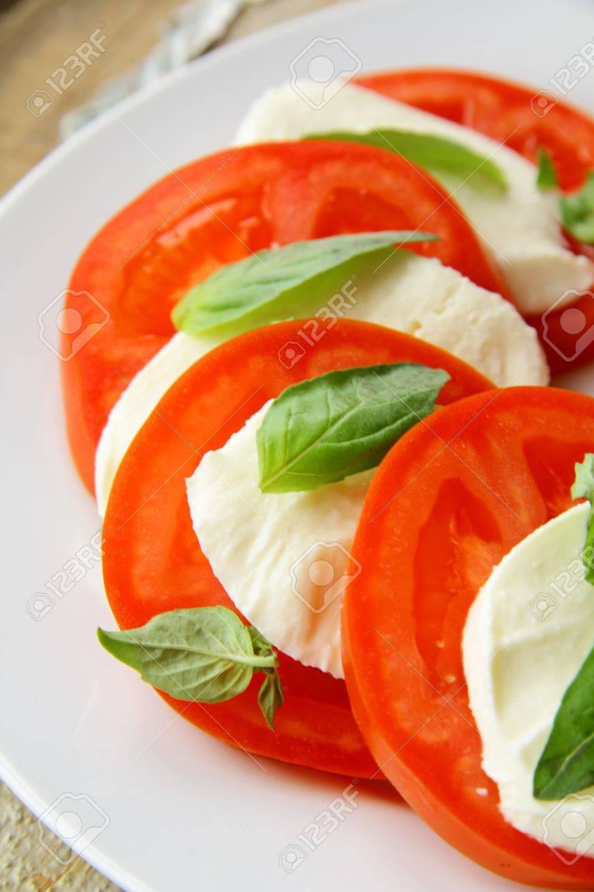 Traditional Italian Caprice salad tomato mozzarella cheese and basil Stock Photo - 11159848