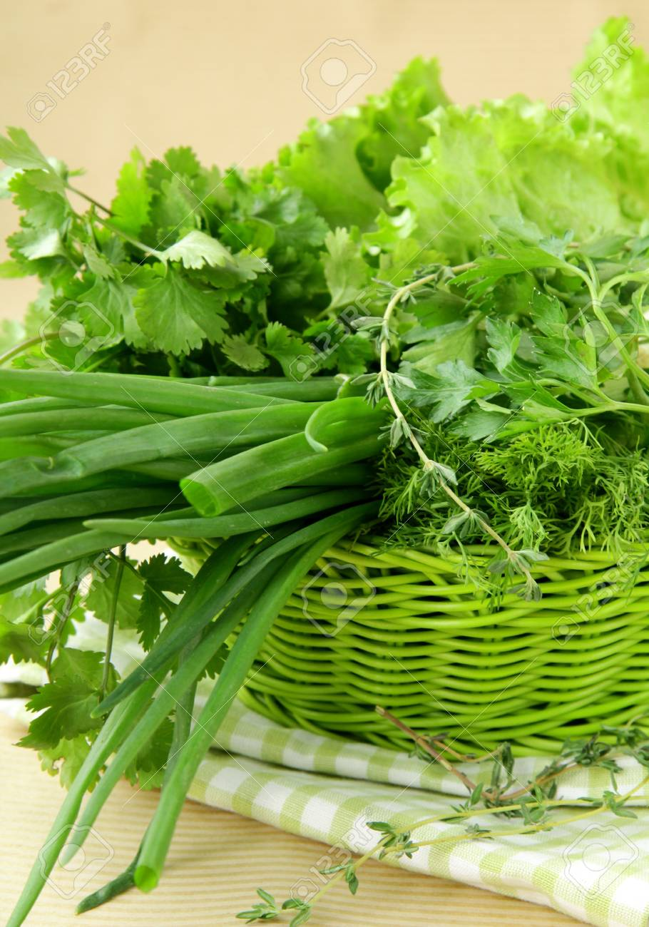 fresh green grass parsley dill onion herbs mix in a wicker basket Stock Photo - 11549782
