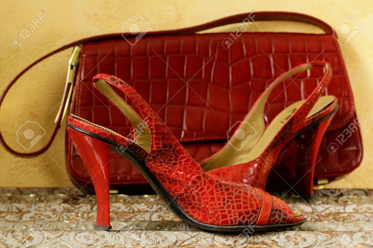 Fashion stylish red women s shoes at the glamorous  background Stock Photo - 12523029
