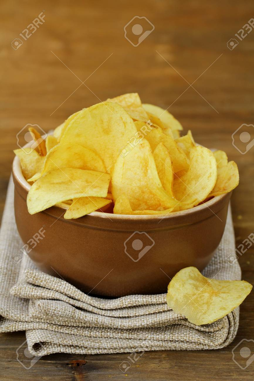potato chips in ceramic bowl on a wooden table Stock Photo - 13830076