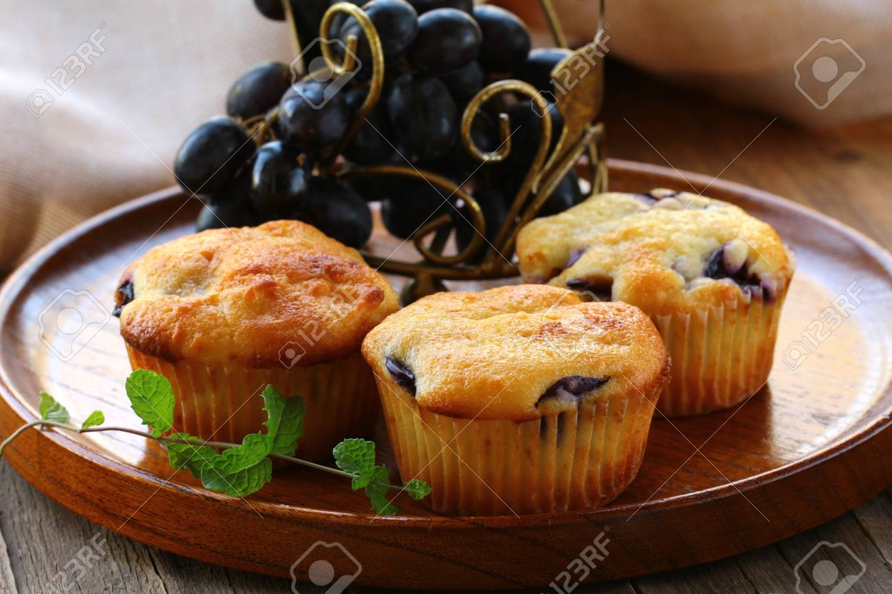 homemade fruit cupcakes on the wooden plate Stock Photo - 15117000