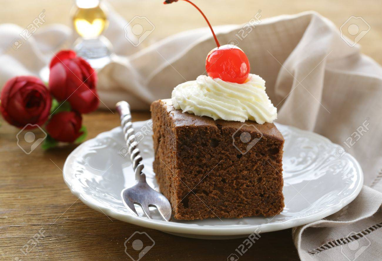 chocolate birthday cake with cherries and whipped cream Stock Photo - 17083891