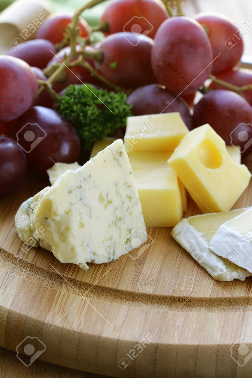 cheeseboard with three kinds of cheese and grapes Stock Photo - 17309088