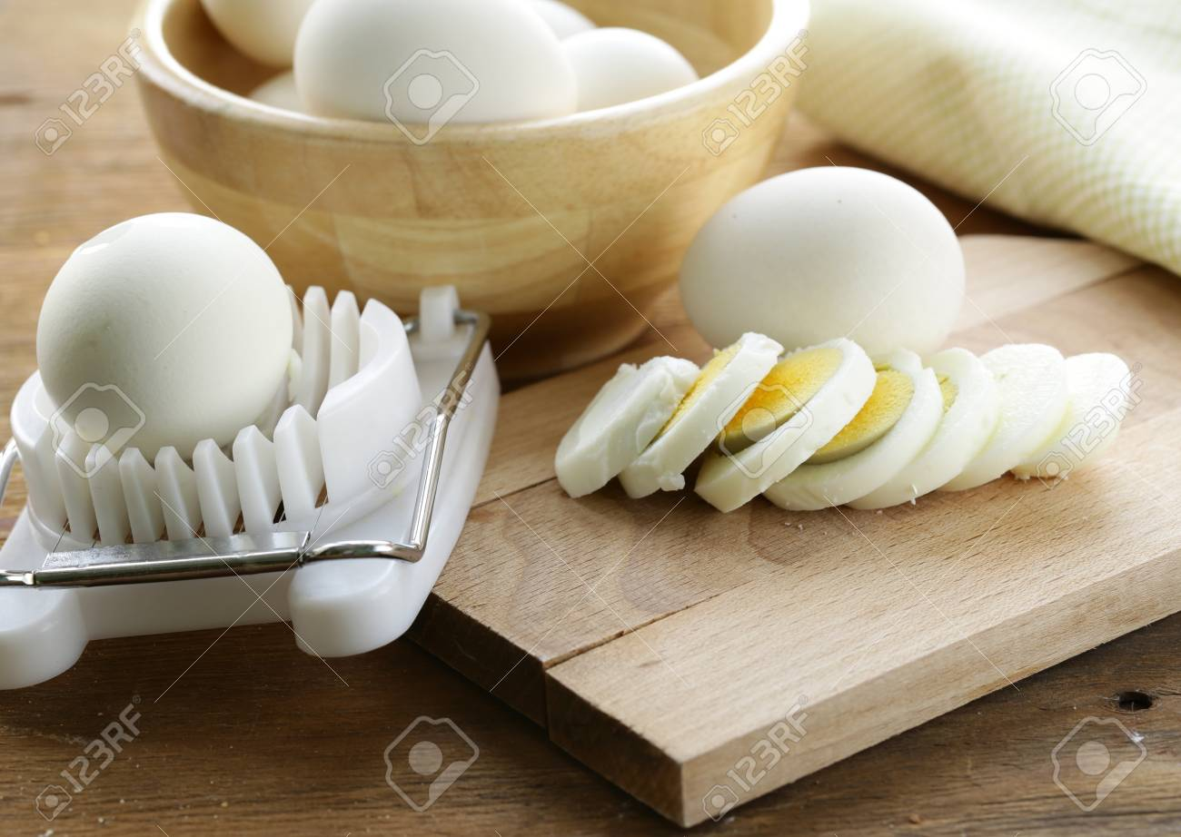 sliced boiled egg for salad on the board Stock Photo - 17593873