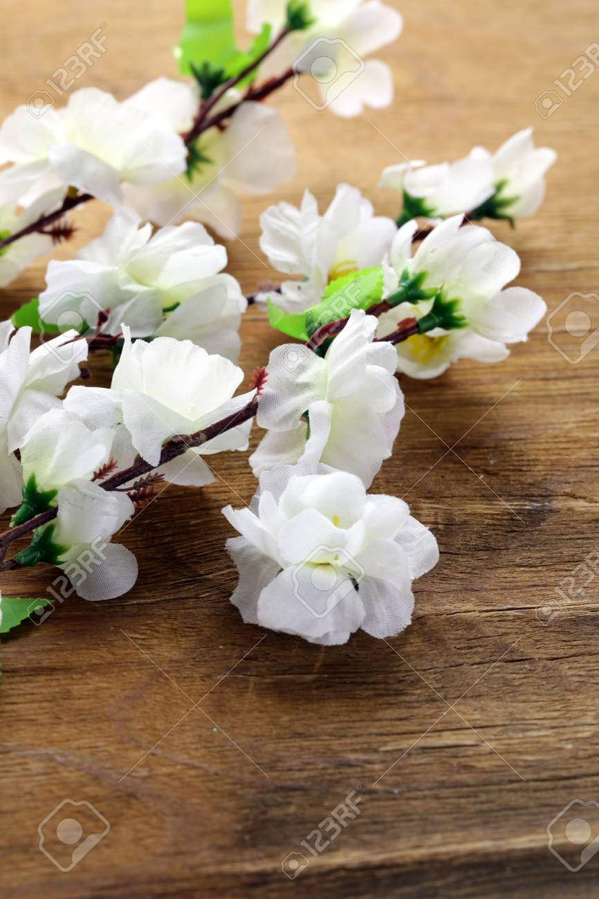 flowering sakura tree branches (artificial) on a wooden background Stock Photo - 18081558