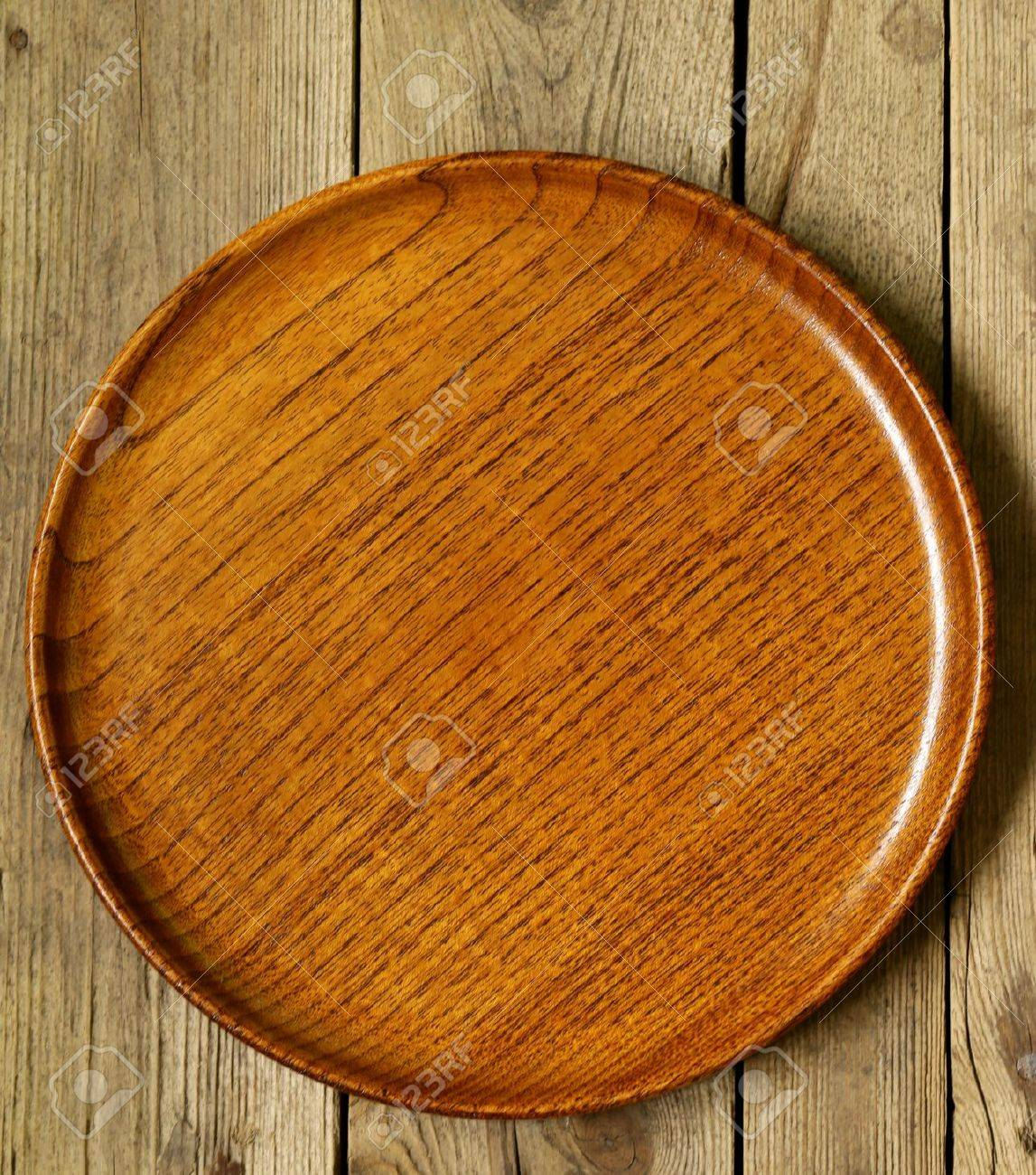 empty wooden plate on the old wooden table stock photo picture and