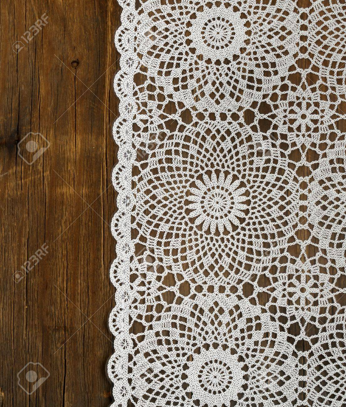 Delightful Lace Tablecloths: Wooden Background With White Lace Napkin Stock Photo