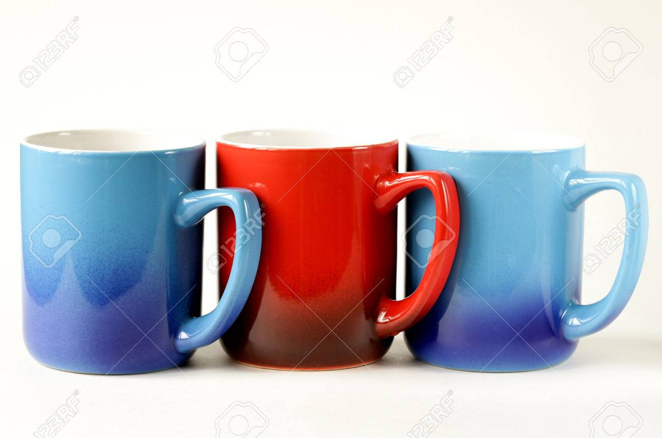 ... Stock Photo Three Colorful Coffee Mugs Blue Red On A White ...