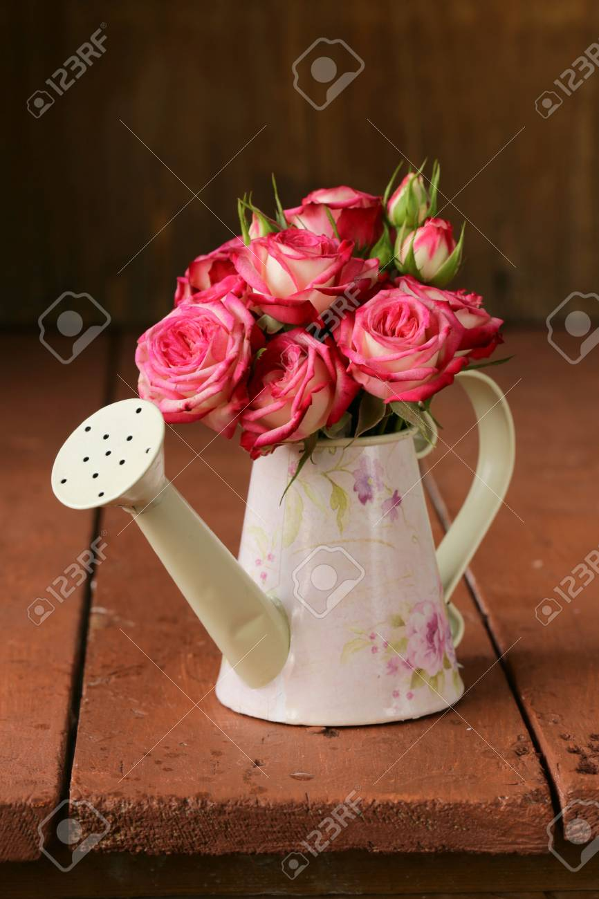 Bouquet of pink flowers roses in old fashioned watering can stock bouquet of pink flowers roses in old fashioned watering can stock photo 25601626 izmirmasajfo