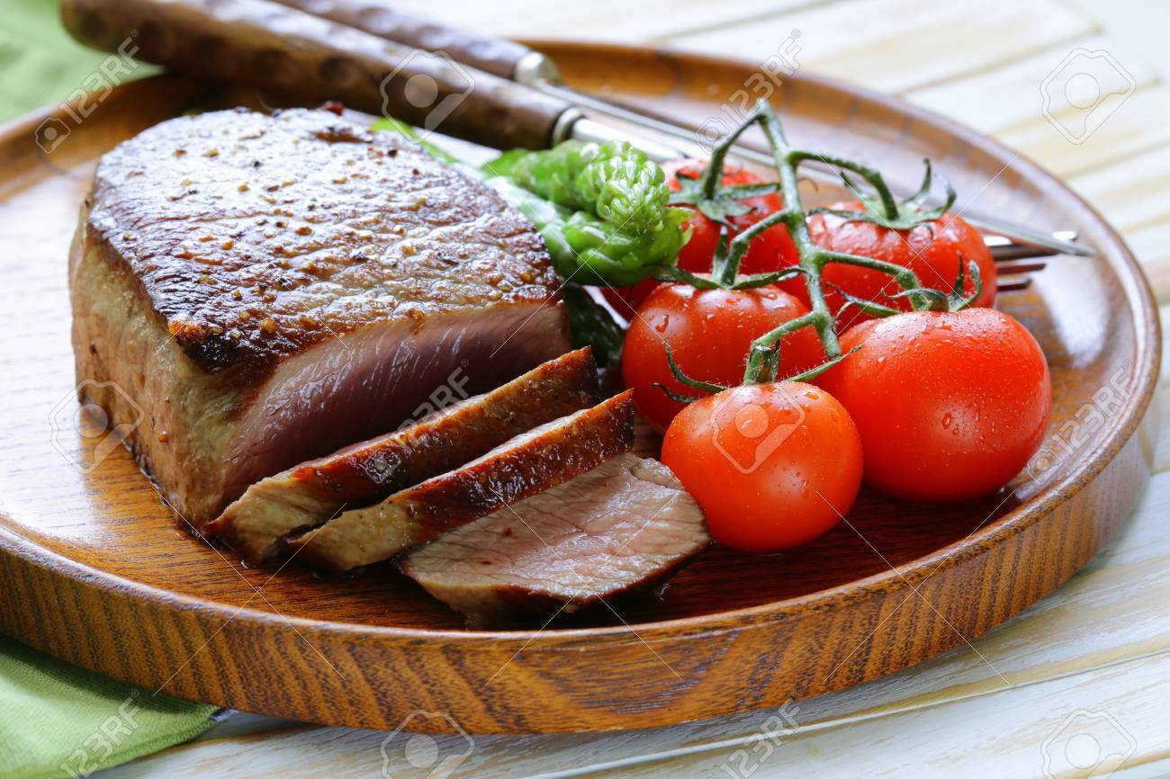 Grilled Meat Beef Steak With Vegetable Garnish Asparagus And Tomatoes Stock Photo 28061872