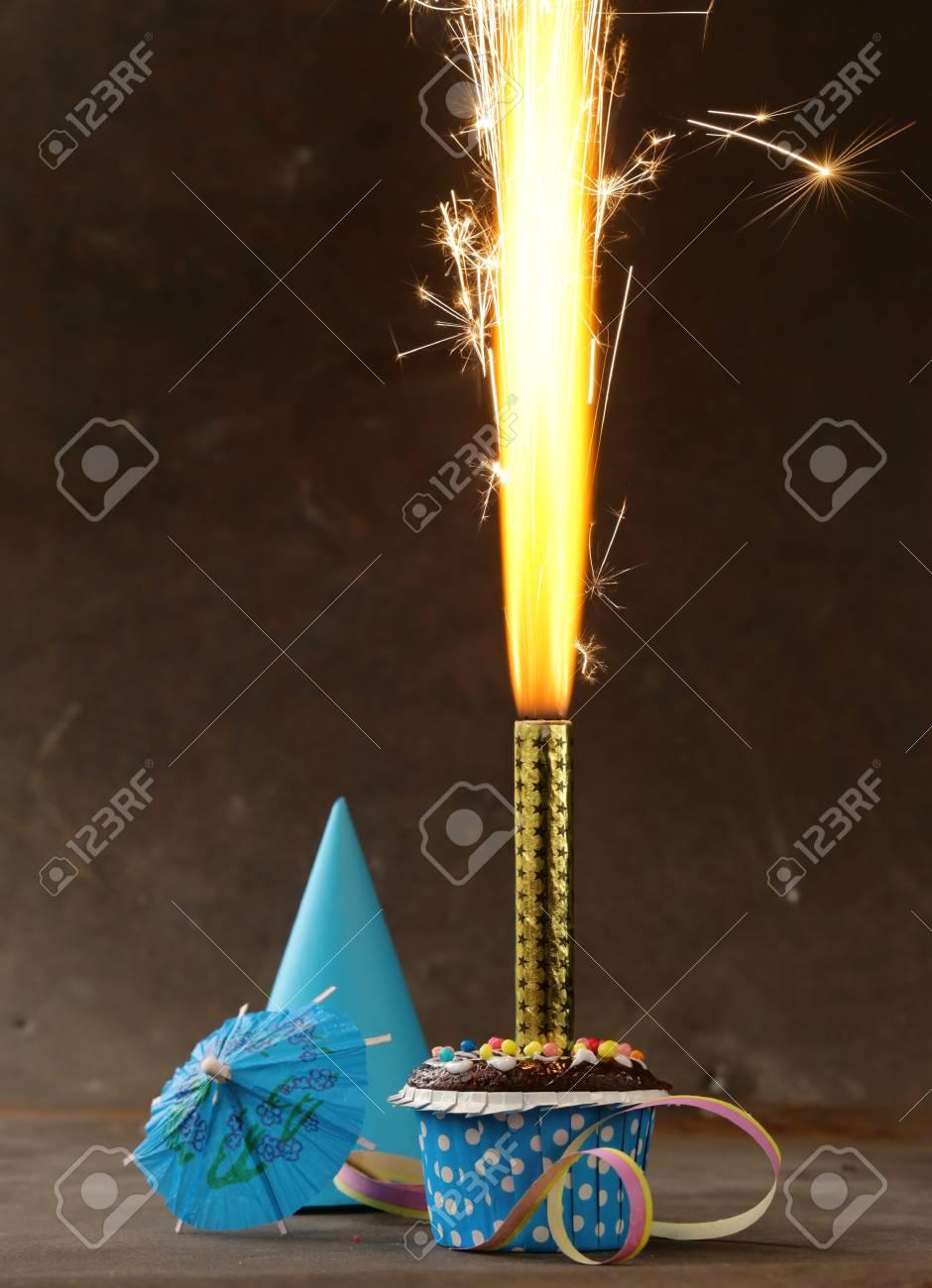 Festive Birthday Dessert Cake With Lighted Fireworks Stock Photo