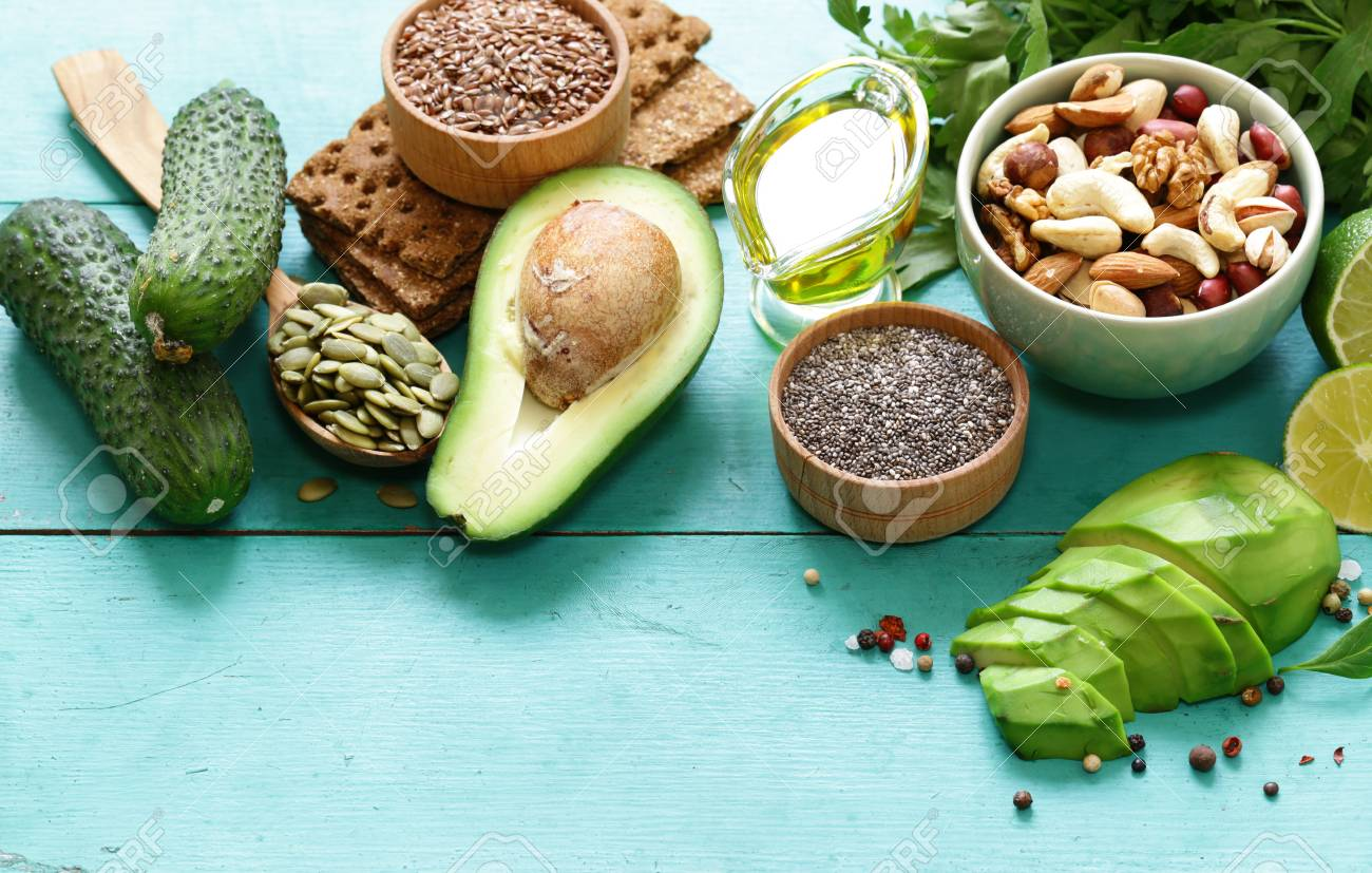 healthy and nutrition food - avocado, chia and flax seeds, olive