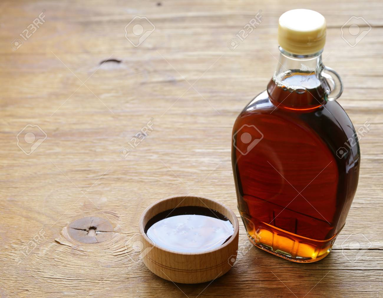 260d6b27849 Maple syrup in a glass bottle - sweet dessert sauce Stock Photo - 95393627
