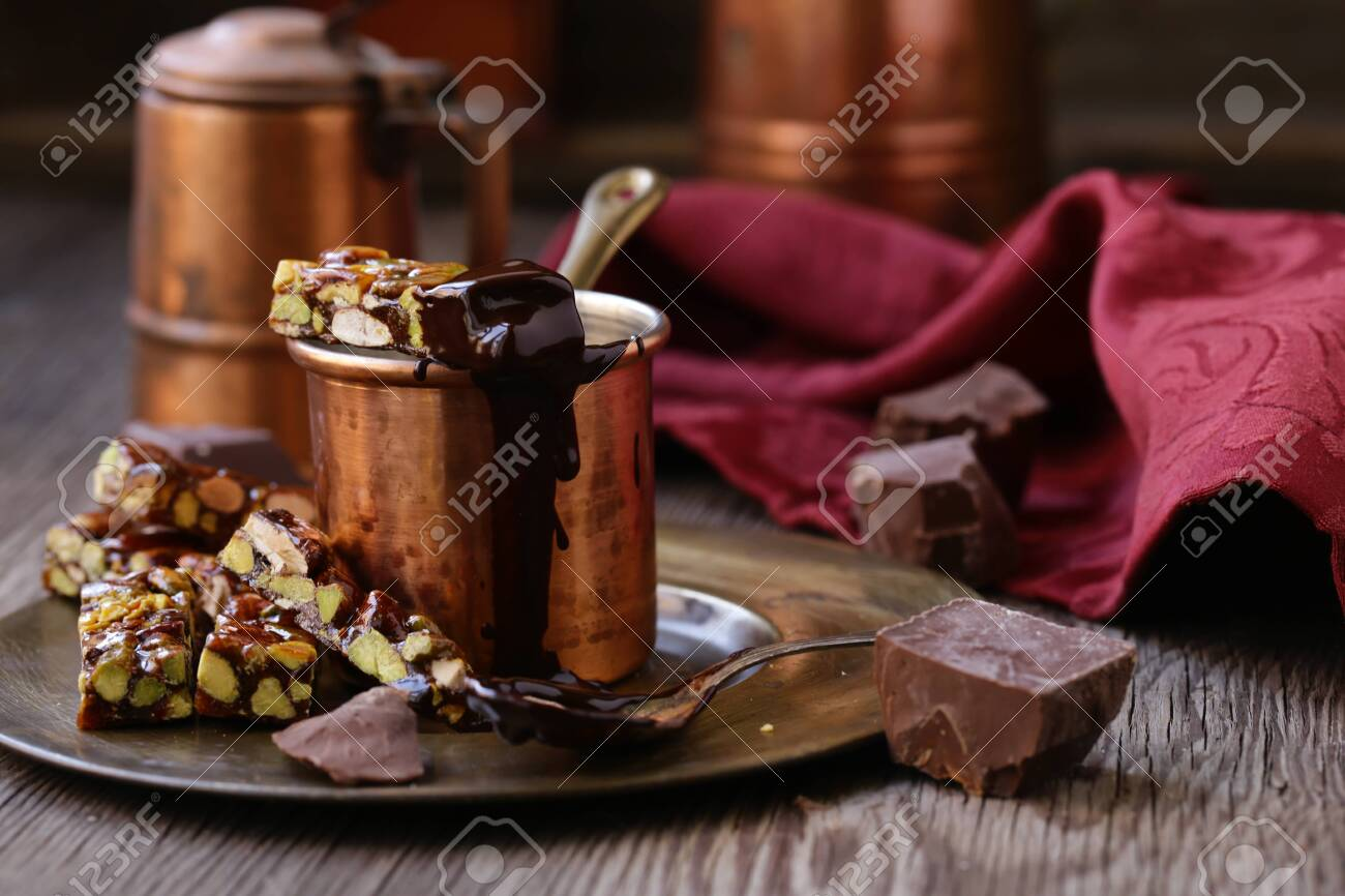 hot chocolate with nutty roasted nuts for dessert - 132749734