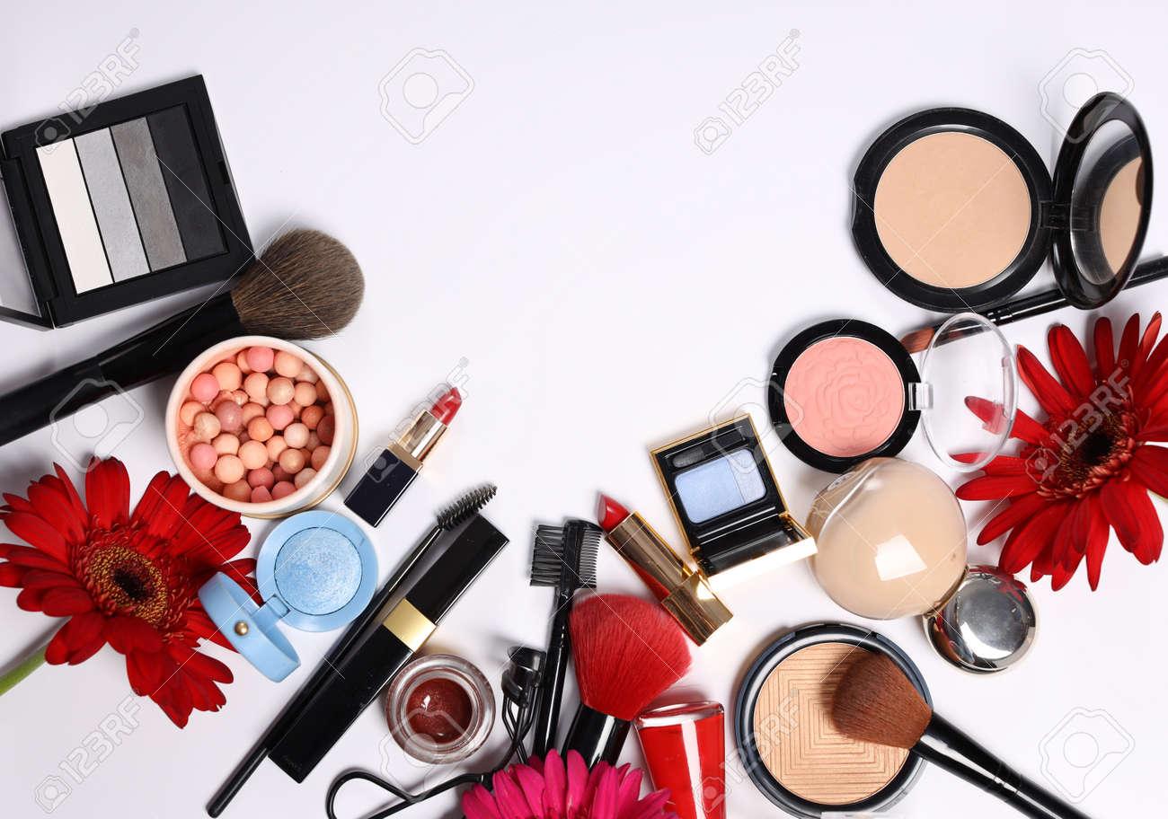 assortment of cosmetics for makeup lipstick powder eye shadow - 155490629