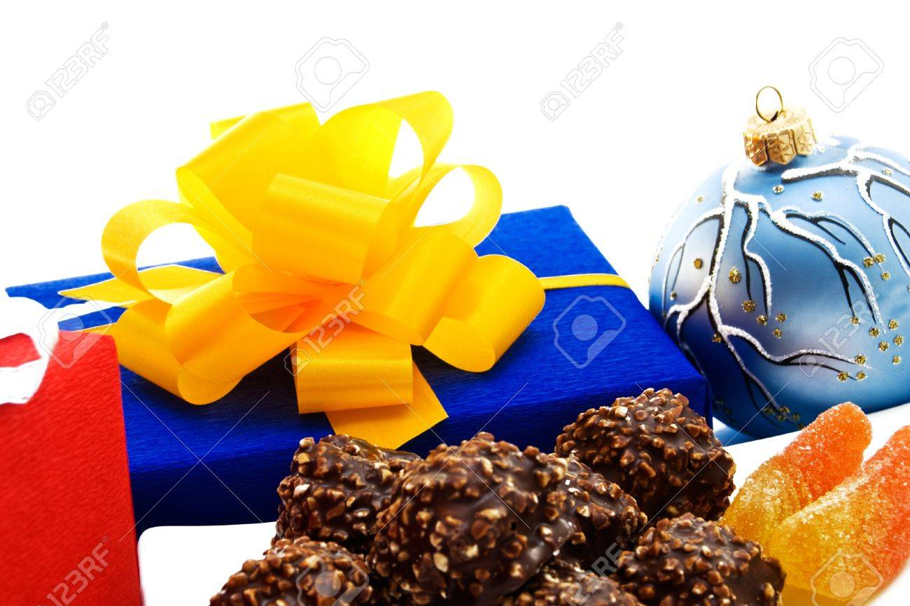 Gift box with ribbon, christmas ball and chocolate candies. Stock Photo - 15840600