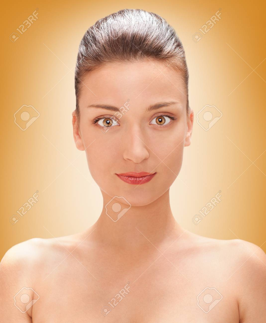 bright closeup portrait picture of beautiful , brown colored eyes woman with yellow background Stock Photo - 14747488