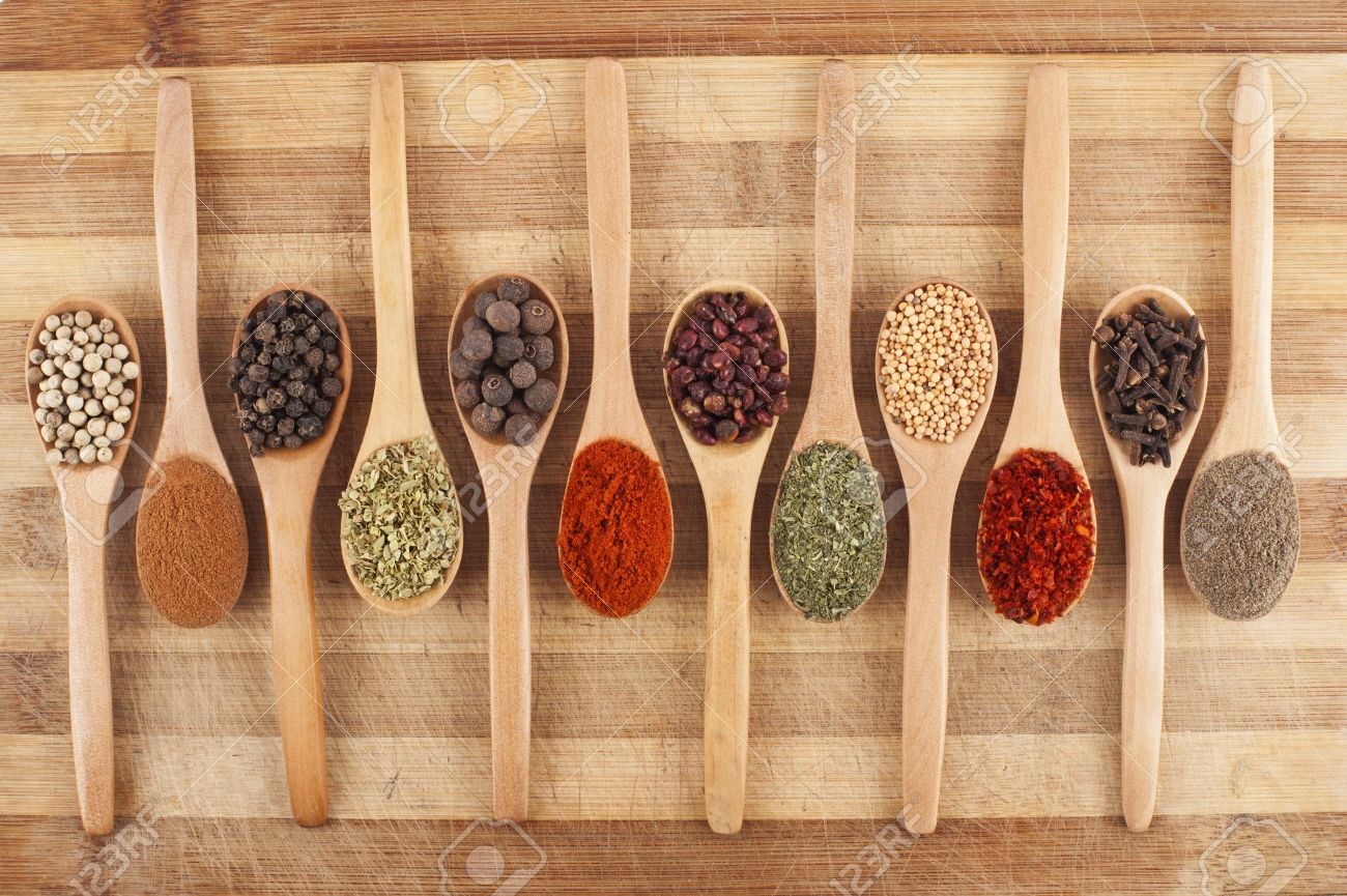 various spices on wooden spoons on cutting board Stock Photo - 15860758