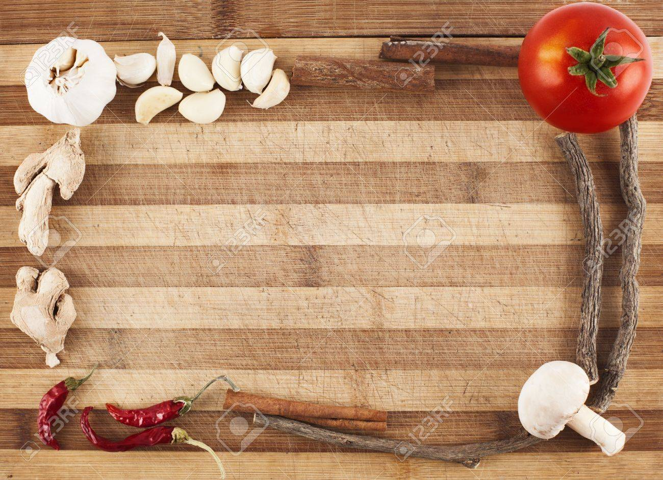 frame made of vegatables and spices on a used cutting board Stock Photo - 15860777