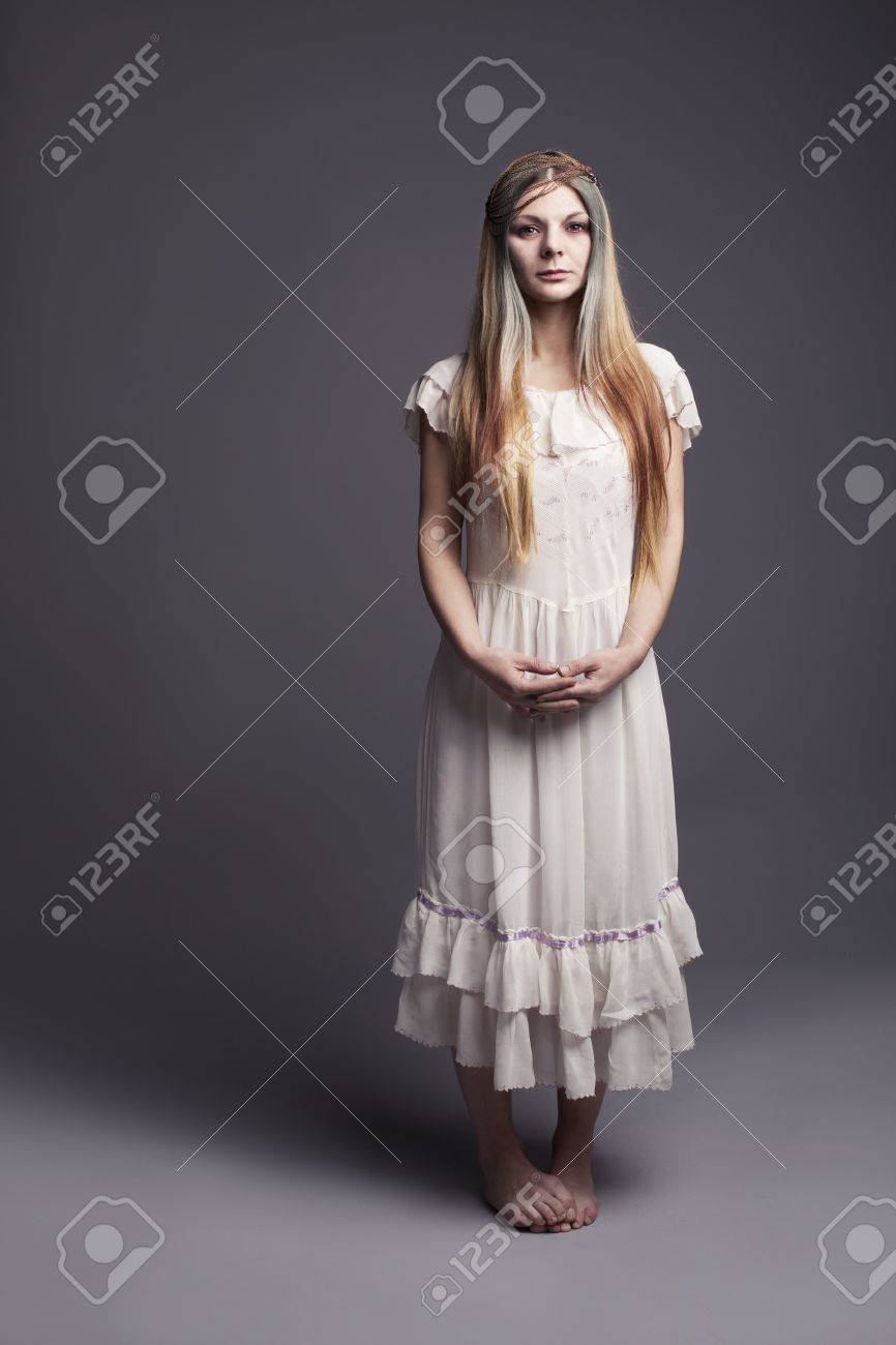 vulnarable barefooted childish girl standing and looking at camera unconfidently Stock Photo - 17639020
