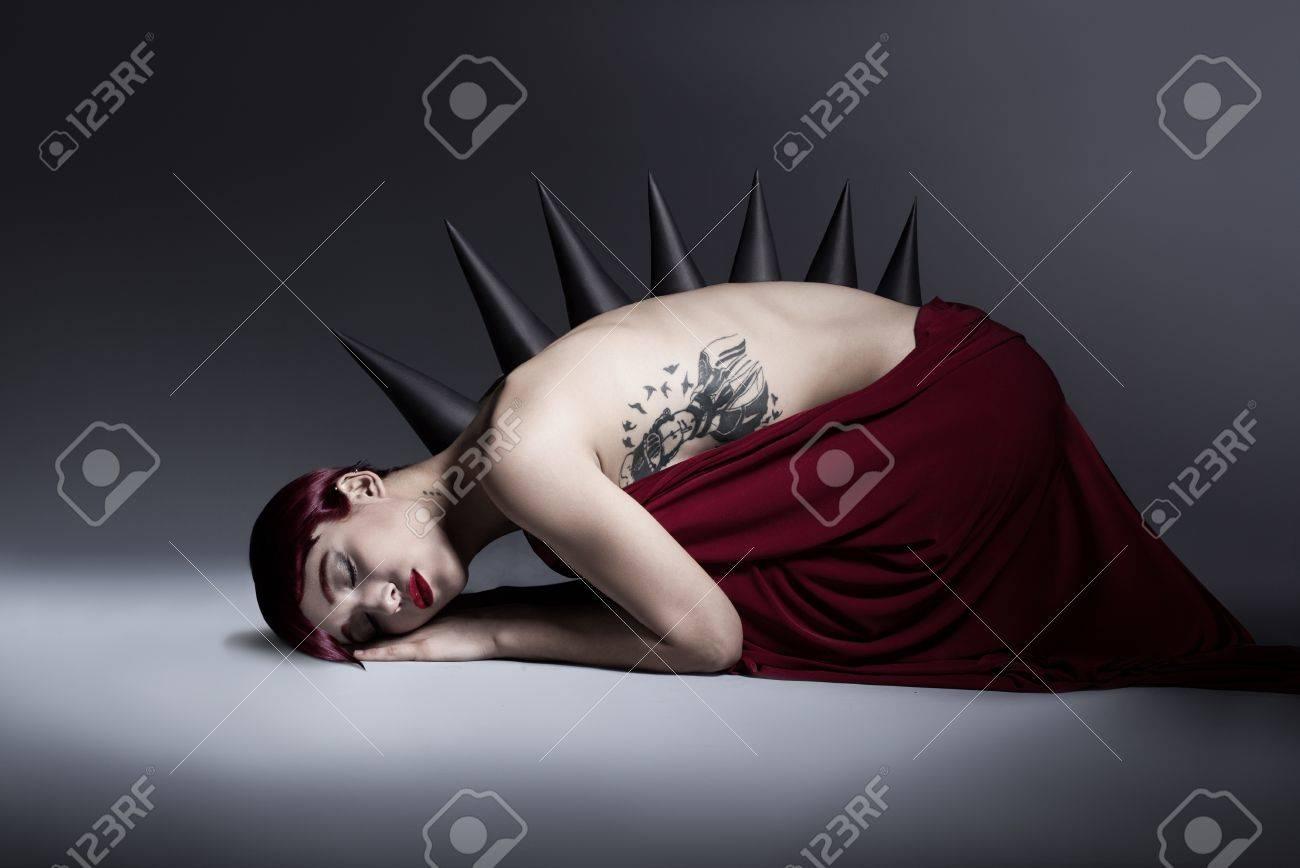 young monster girl sleeping on the floor on dark background Stock Photo - 17639063