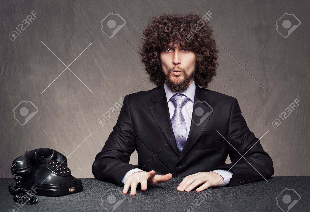 bored young businessman giving a whistle while waiting for the phone ring on grunge background Stock Photo - 18617289