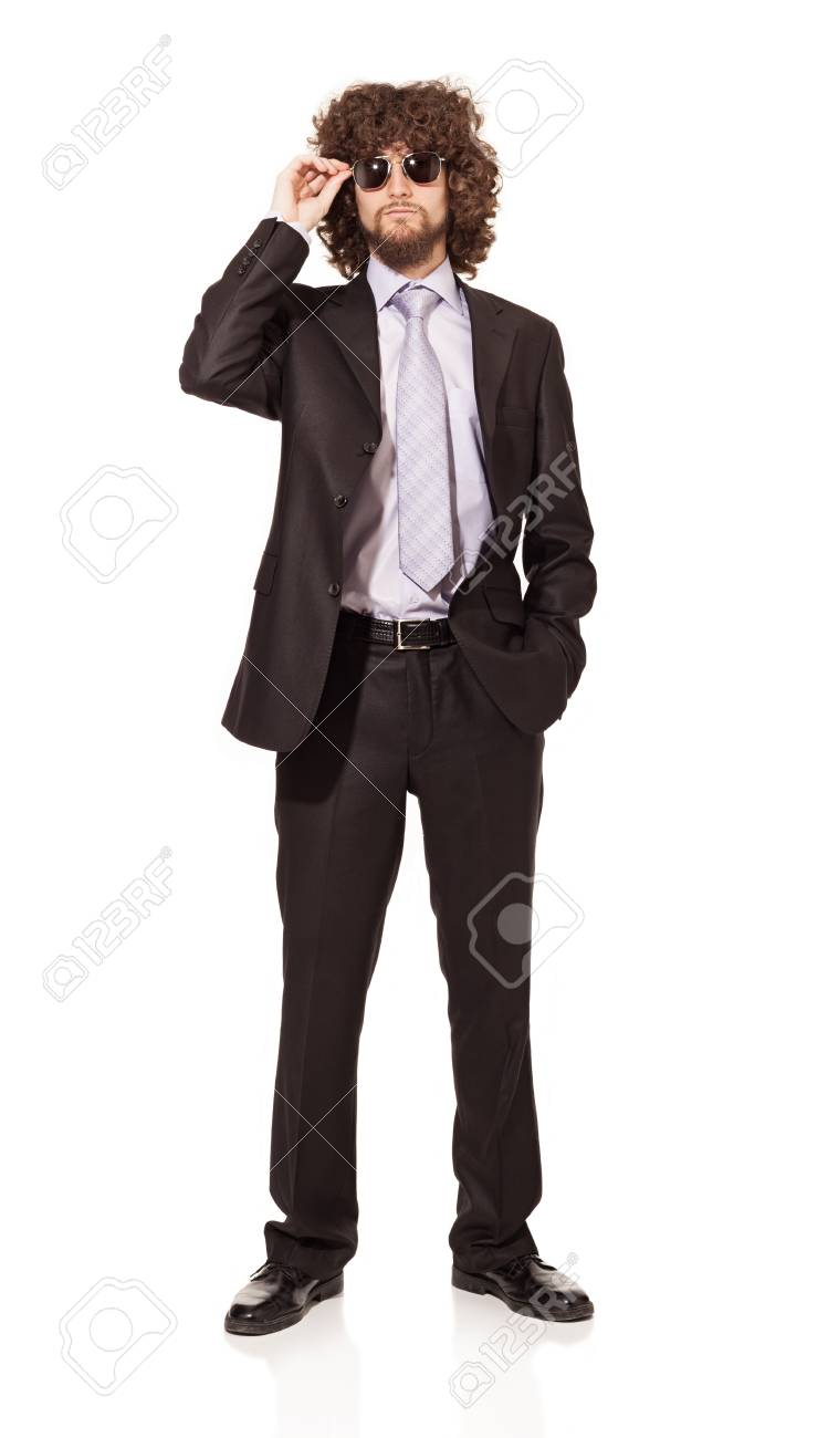 young man wearing suit and sunglasses isolated on white background Stock Photo - 18616925