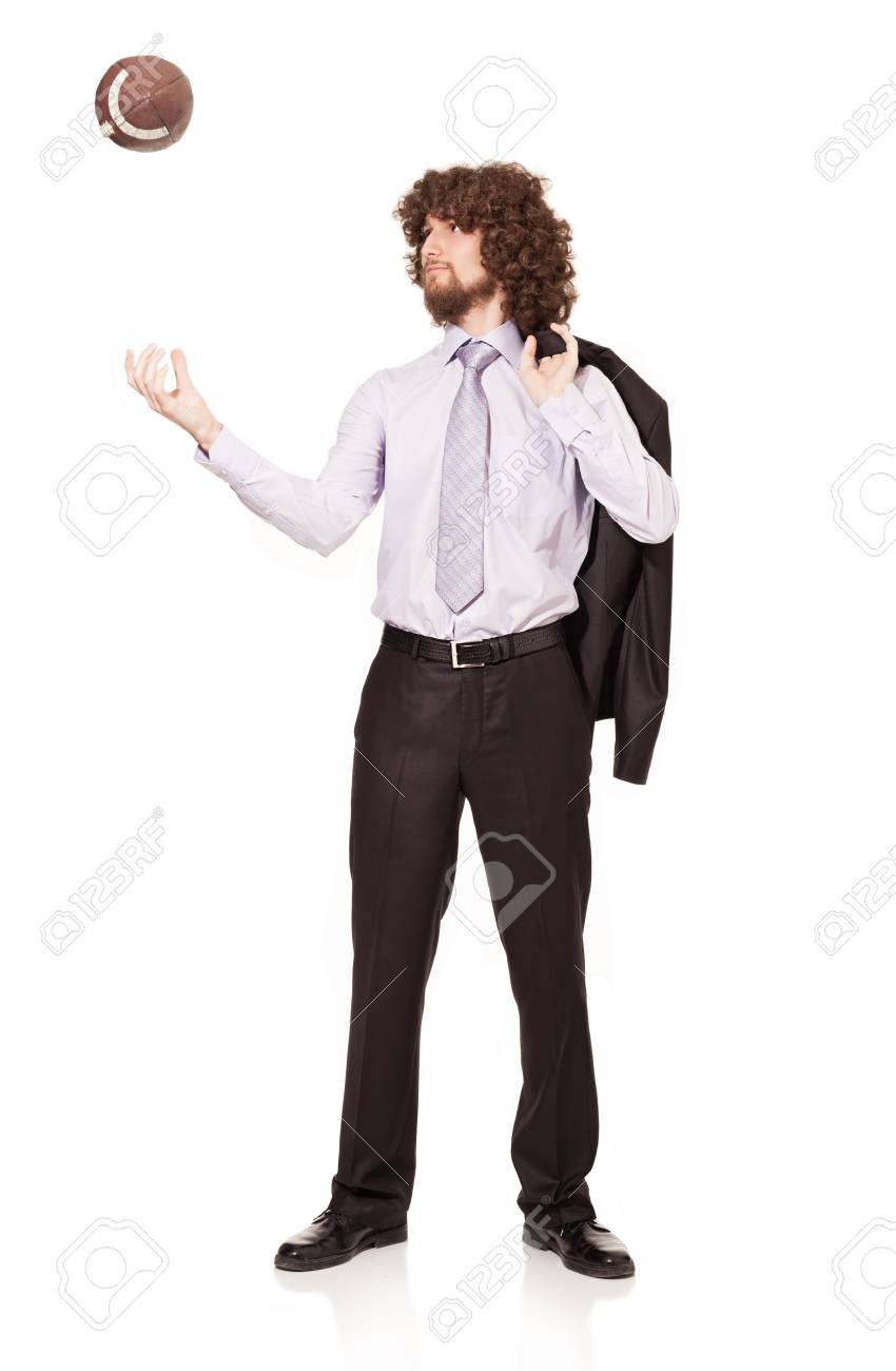 young businessman throwing a ball in the air isolated on white background Stock Photo - 18616540