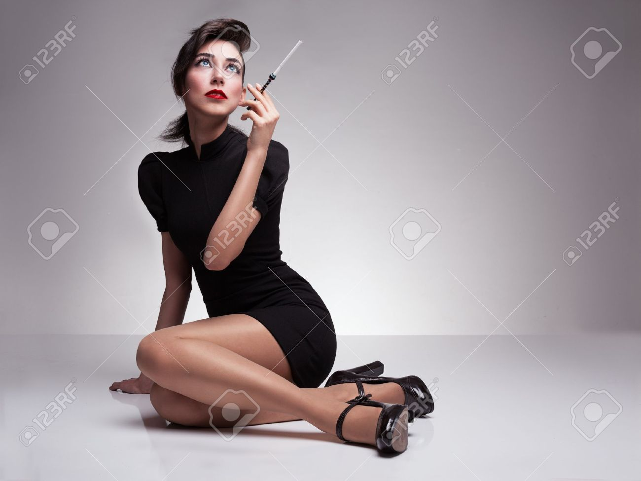 Beautiful Lady With Black Dress And High Heels Holding A Cigarette ...