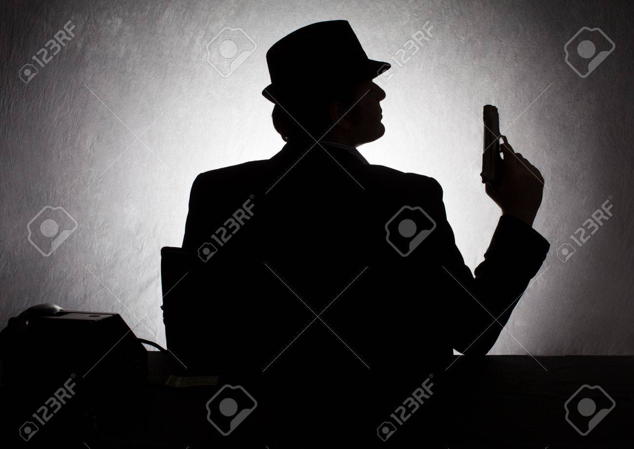 silhouette of retro style gangster holding his gun on grunge background Stock Photo - 20972154