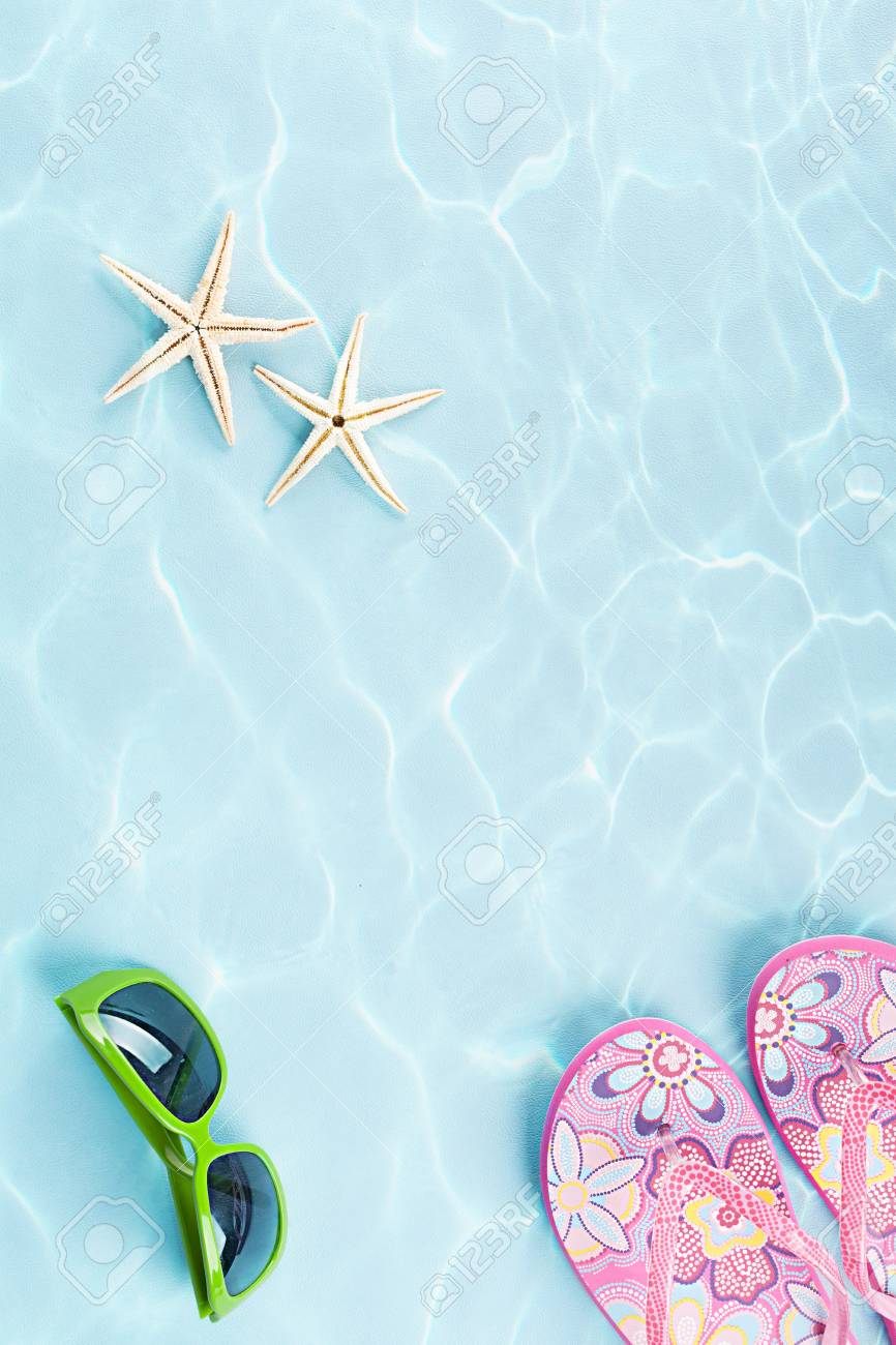 two starfishes, sunglasses and flip flops under water on blue background Stock Photo - 20972248