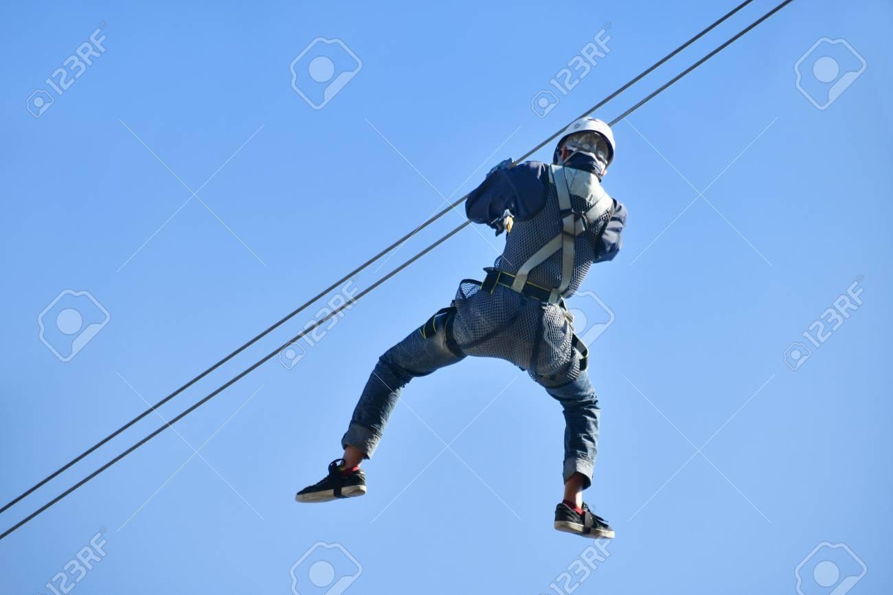 Men enjoy the zip line - 76075003