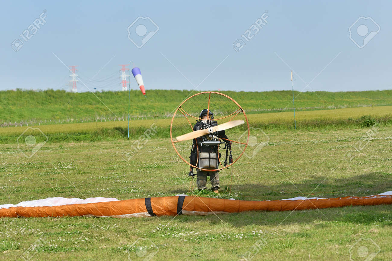 Motor paraglider ready for takeoff - 168587566
