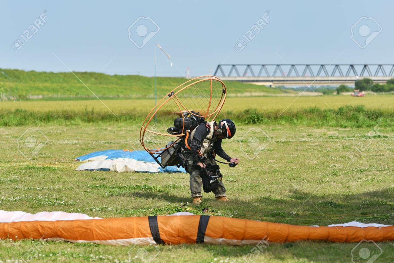 Motor paraglider ready for takeoff - 168587722