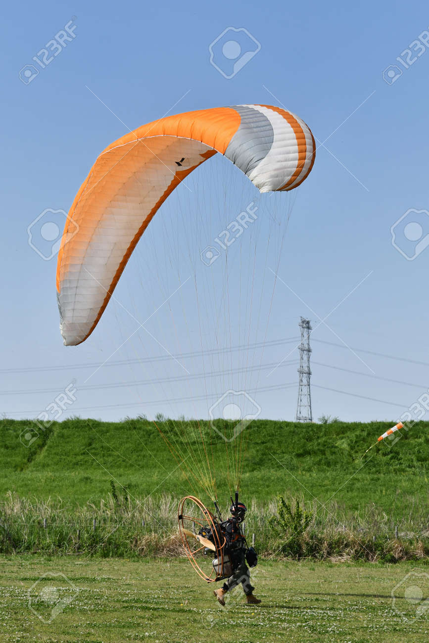 Motor paraglider ready for takeoff - 169893948