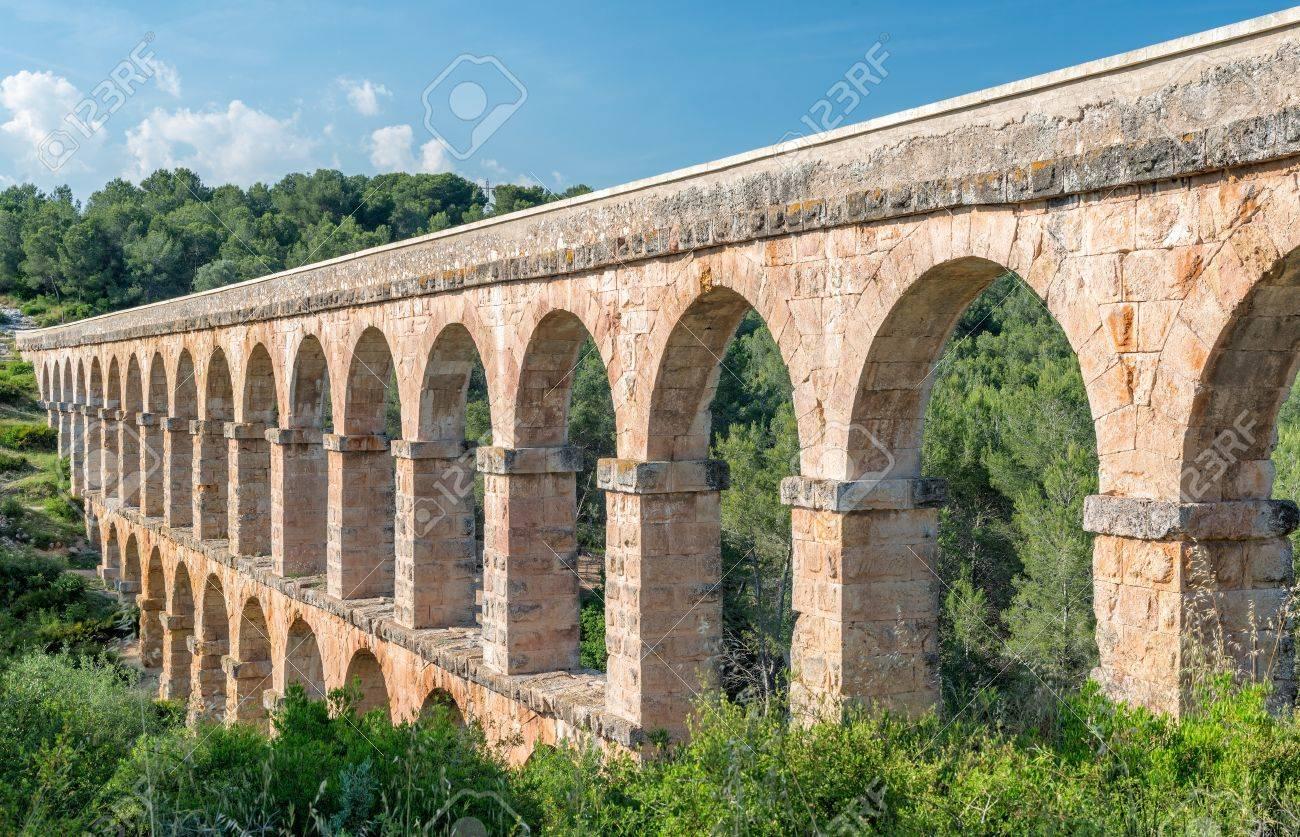 close up view of roman aqueduct in tarragona spain stock photo