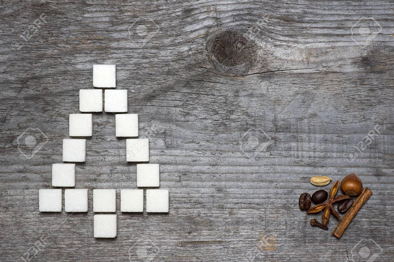 Christmas tree greeting card made of lump sugar and spices on christmas tree greeting card made of lump sugar and spices on wooden background stock photo kristyandbryce Gallery