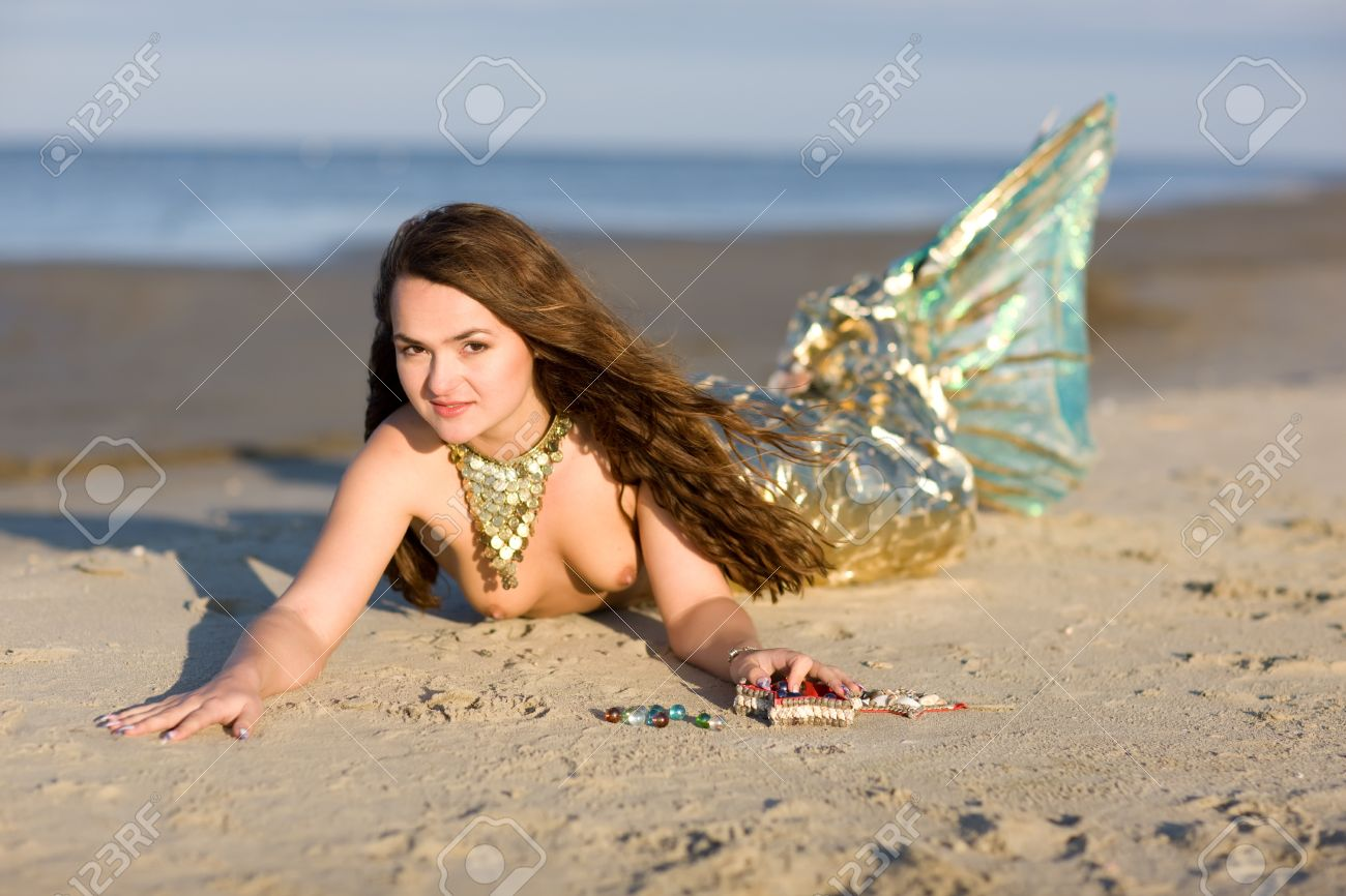 mistycal creature of sea beautiful mermaid with real fish tail