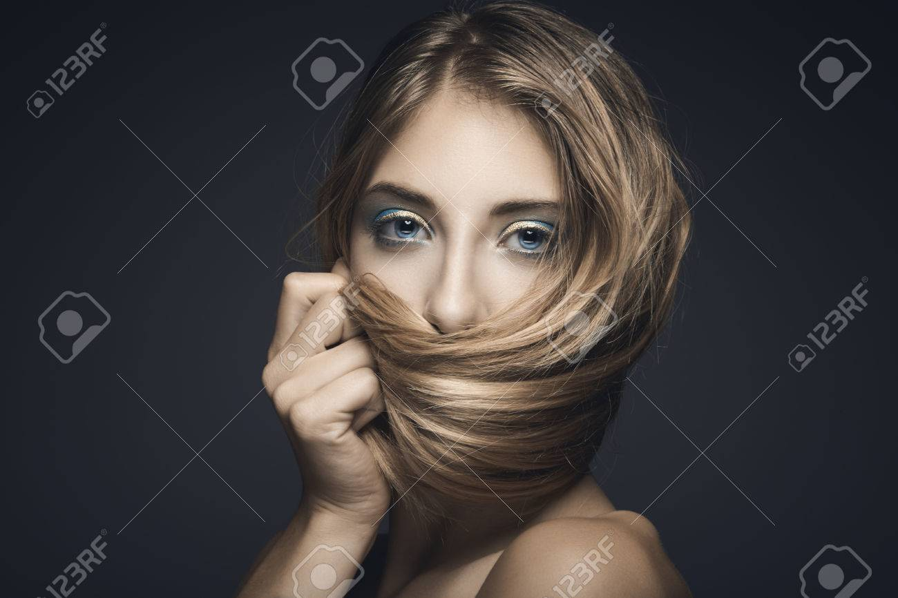 Beauty portrait of young sexy woman against blue background Stock Photo - 30530675