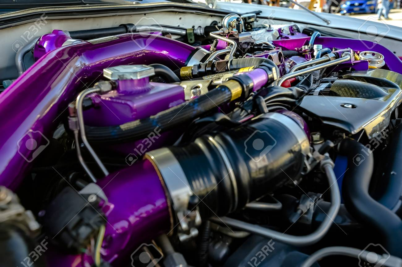 Purple Pipes In A Modern Car. Engine And Other Mechanical Components ...